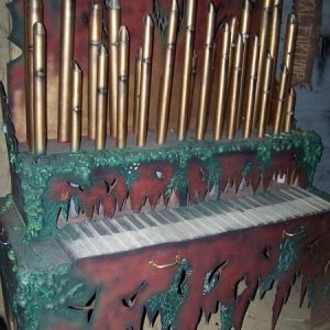 Haunted Pirate Organ built in 2008, made from various woods, pvc and foam, the demonic creature can be seen when it's lit from behind.