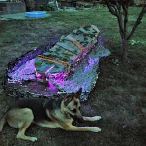 coffin at night. I added some haunted tape, chains, and the grave yard border from the dollar store.