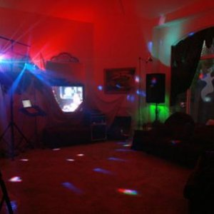 Our dancefloor for 2009.  My husband invested in some DJ lighting and scaffolds.  Cheap paint tarps from Dollar Tree worked great to drape over the sc