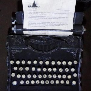 Top view of typewriter with letter .