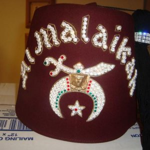 My husband's going to be a Shriner for the party. Scored this authentic fez for only $7 on Etsy. Woot!