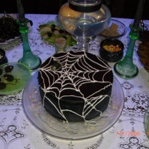 another view of the cake, surrounded by vaseline glass serving ware that fluoresces under black light.