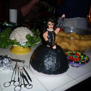 My Sweet Transvestite cake from 2008.  I painted Malibu Ken to look like Dr. Frank N Furter and put him in a Wilton wonder mold of red velvet cake.  I