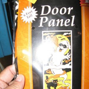 Ghost door panel--10 cents, new in package