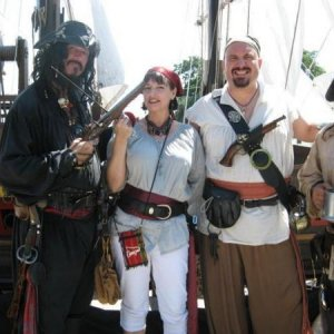My friend Anne, me, and some random pirates off the street at the Treasure Coast Pirate Fest in Stuart, Florida.