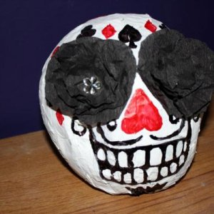 Handmade papier-mâché calavera, this one is casino themed as an homage to Manny Calavera from the game 'Grim Fandango'.
