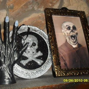 Various things I bought. The Handelabra is from Party City, the skull plaque is from Marshall's and the changing picture is from Dollar General