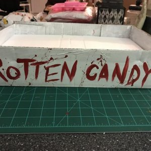 "Added some styrofoam to hold lollypops and other ""rotten"" Halloween candy"