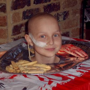 my daughter as a head on a plate. She was having chemo at the time, so she looked even more scary.