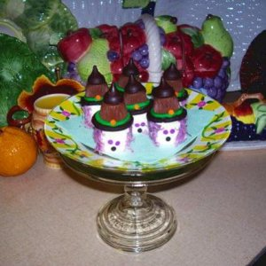 Marshmallow Witches ~  Dyed coconut hair with hats made of ½ an Oreo cookie topped with a mini Reeses cup and a Hershey's Kiss.