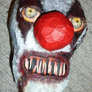 11: And here is the head from front. As you can see, I added a black cardboard behind the teeth.