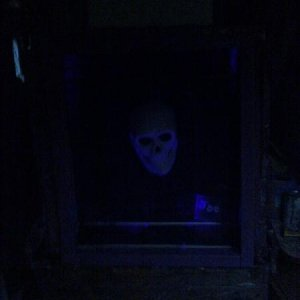 Ticket Booth/Joe at Night: Lemax Spookytown black lights.