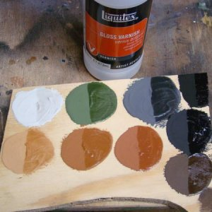 Colors used for griming. The upper right is simple black paint. One half of each circle shows the look after gloss is applied.