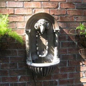 Love this fountain on our porch. It was cast off an original so its concrete but still has nice spooky detail.