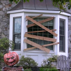 Just added the bay window boards this year and pumkin head skeleton.