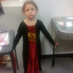 Tori trying on her outfit.  Dont let her expression fool you..she was having a good time