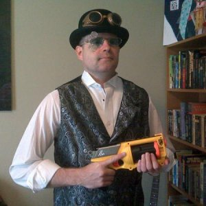 Aaron's steampunk costume test run.  I've got to paint the gun and buy some spats.  Wire rimmed glasses with clear lenses and black sleeve garters hav