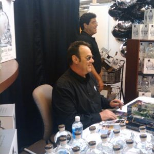 He is getting ready to sign my Crystal Head bottle.. :)