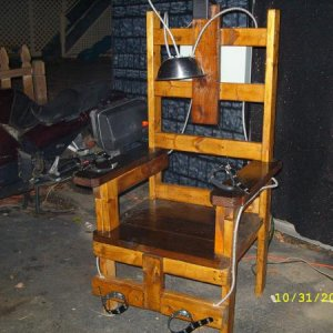 the electric chair used as a photo oportunuty shot digital picture for free posted on web for people to download strobe and sound track kicked off by