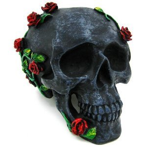 I would love this creeping roses human skull statue from Amazon!