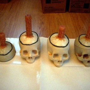 Real wax candles built up on skulls for making molds.