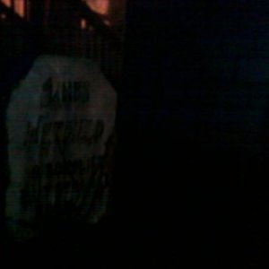 Night shot of James Hetfield's tombstone.