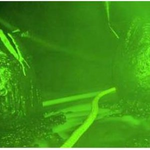 Alien Egg scene room under enhanced green ambient lighting (some residual fog in the image.)