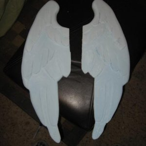Step 6.  After drawing the pattern on the foam wings, I used a router and a dremel tool to carve the shape into them.