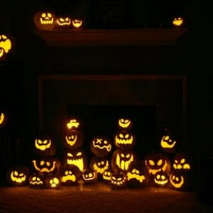 33 of my foam pumpkins lit around my fireplace just for the fun of it.