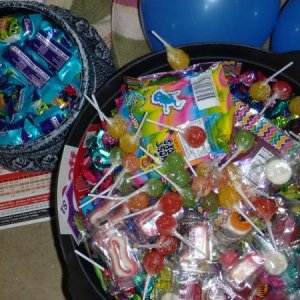Halloween candy! A cauldron full of 160 Freddos and a larger cauldron full of 100 toffees, novelties, lollipops, gummy lollies etc.