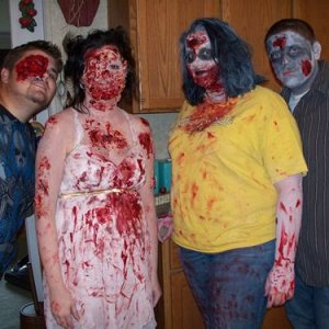 My husband, me, bro-in-law's gf, bro-in-law on Halloween Eve night.  Everyone's make-up/face was done by my husband.