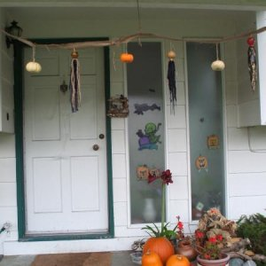 The front door with the gourd-ghoulie and mini-pumpkin garland I threw together last minute.  Alas, we didn't have time those last few days before Hal