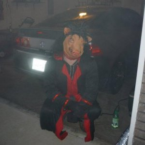 This is me in the saw costume before the night began. We lowered the garage door to just enough space where i could crawl out from under it, the fog c