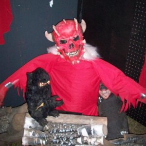 half manniquin dressed as  our devil with fake fireplace logs and rats around him. I also had an actor devil in this room