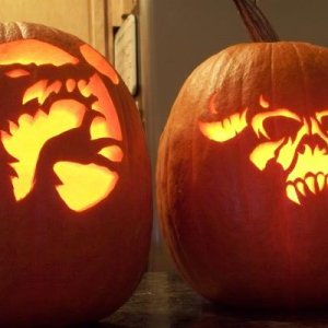 100 1836 Our actual Halloween night carvings, mine is on the left, my daughter is to the right.