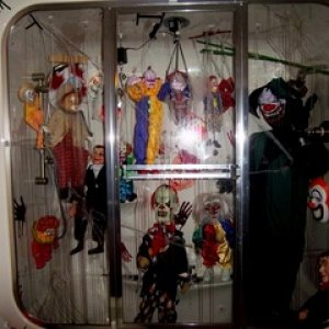 Basement Bath Puppeteers Closet (inside had strobes, color changing LED, dolls on turning motors, and a small convulsing clown doll in bottom of tub)