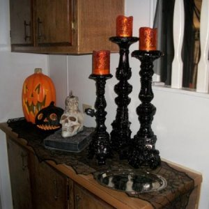 Picture 056 Daylight shot of the Black Gothic Candlesticks, Book Skull, and Jack-o-Lanterns.