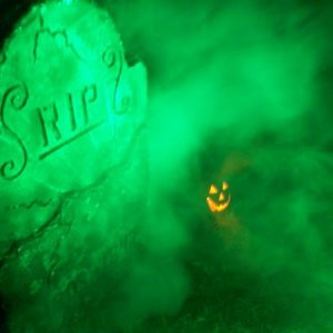 Picture 078 In the foggy relms of a grave, flickers a smiling Jack-o-Lantern...