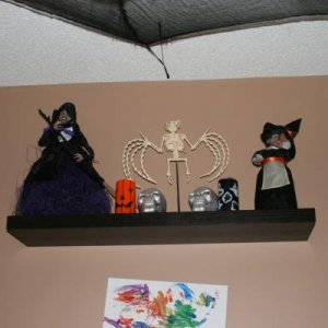 my halloween shelf...the old witch on the right was one we gave my nan back in the early nineties...she gave it back to me knowing how much I love hal