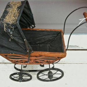 GOODWILL, 2011. Gothic-looking baby carriage complete with Spanish moss on it. Probably donated by a fellow haunter. It even creaks when you push it!
