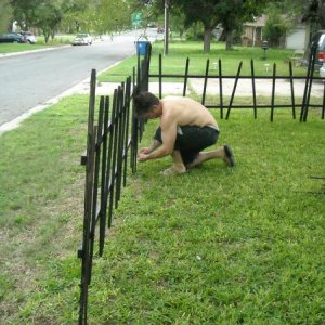 Hubby helping me with the cemetery fence