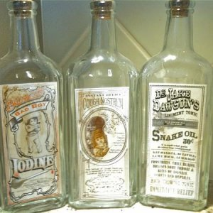 "HOME GOODS, 2011. Found these ""vintage"" bottles for $4.99 each that will be a great prop accessory for my carnival barker prop. Saw only the"