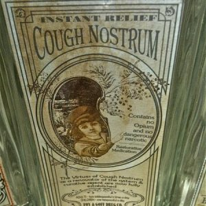 HOME GOODS, 2011. Close up of cough syrup.