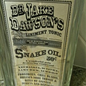 HOME GOODS, 2011. Close up of snake oil tonic.