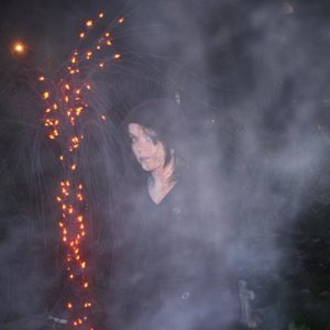 Halloween night: Me beside our halloween tree in our cemetary in our ver tiny front yard...