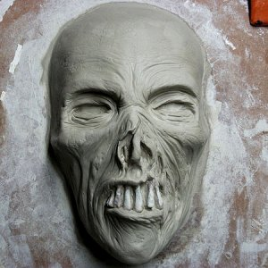 Half mask, wed clay, ready to mold.