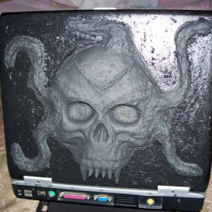 My haunted Laptop with a customized molded Lid. It is a mixture of hotglue, paper mache, and sawdust. Oh and some straws too... :)