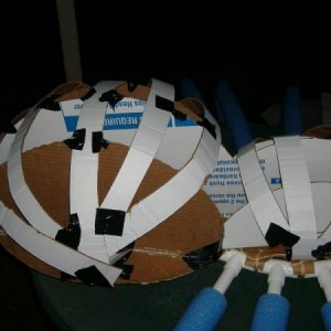 Detail of cardboard supports for the paper maché. You can also see the t connectors and lengths of pvc that were pushed into the pool noodles. Bottom