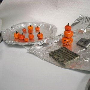 Painted clay pumpkins and small walkway for Spookytown village