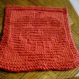First time knitting a pattern, of course I chose the jack-o-lantern dishcloth :D